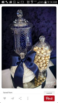 Kat has many glass containers, bought plastic Togo bags,  silver gum balls, and silver ribbon to tie the bags off. We need more silver and navy candies.