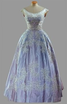 """Formal Gown, Norman Hartnell: 1961, faille dress embroidered with china beads. """"Worn [by HRH Queen Elizabeth II during the State Visit to Pakistan, February 1961."""" The Queen also wore this dress during the State Visit of King Olav of Norway to Britain in 1962."""