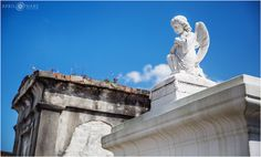Angel statue sculpture on an above ground tomb at Saint Louis Cemetery No. 1 in New Orleans, LA. - April O'Hare Photography http://www.apriloharephotography.com