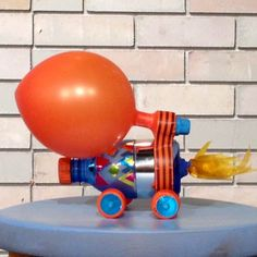 This might be a craft do-able for the older kids! Make and decorate a spaceship/car from the water bottle, attach wheels (make those from the bottle caps?) and then attach a balloon to the top where they could blow it up and race the cars with each other (maybe in the dining hall for a flat surface!)  The only problem I can see would be finding a way to attach the wheels so they would roll, but if we could do that, this would be a really fun craft!!
