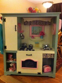 Entertainment center upcycled into little girl's dream play kitchen!