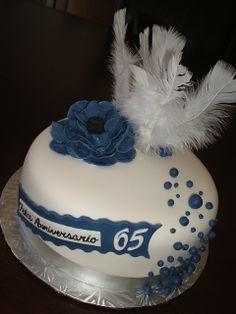 This cake is for a 90th Birthday and a 65th Wedding Anniversary. Therefore, the view of the cake has different meaning; it's a red velvet with cream cheese buttercream. Everything is edible except for the white feathers.