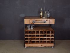 @ #bareknuckleworkshop in Chicago-Carol's Custom Industrial Bar Cart #10 with 64 bottle slots, made of pine, steel and black pipe with casters.