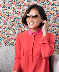 Impress and amaze with gold Miu Miu sunnies to accent bright colors like this vibrant coral blouse.
