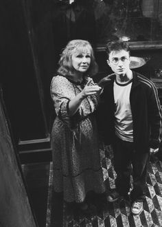 Mrs. Weasley and her 7th son, Harry