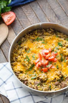 Ground beef, rice, cheese and pickles make this cheeseburger skillet dinner a meal that will please the entire family, even the pickiest eaters!