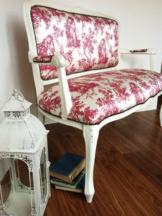 Vintage red and white toile fabric on settee