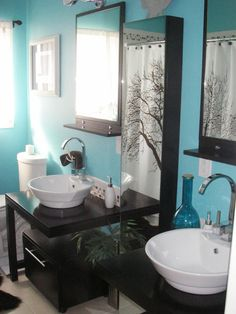 Modern Blues  With black mirrors and vanities, RMS user tiki262 brightened up a dark bathroom with turquoise on the walls, a white-tiled tub surround and flowing white curtains for softness.    HGTV Idea