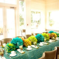 Put tissue paper flowers as a centerpiece instead of hanging them