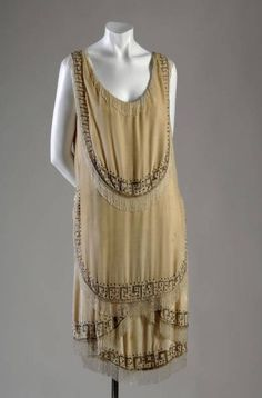 "Evening Gown, Gabrielle ""Coco"" Chanel (1883-1971), Paris, France: 1926, silk velvet, rhinestone, glass beads, fringe. ""This garment is one of the best examples of flapper-style dress in the Museum's collection. The flat silhouettes and fringe are common features of dress from the 1920s."""