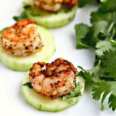 Spicy Blackened Shrimp over Crispy Cucumbers, marinated in cilantro and lime to cool things off. An elegant and delicious party appetizer!