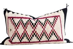 Pillow custom-made in 1940s Navajo handwoven cotton. Backed in solid black linen with feather and down fill.