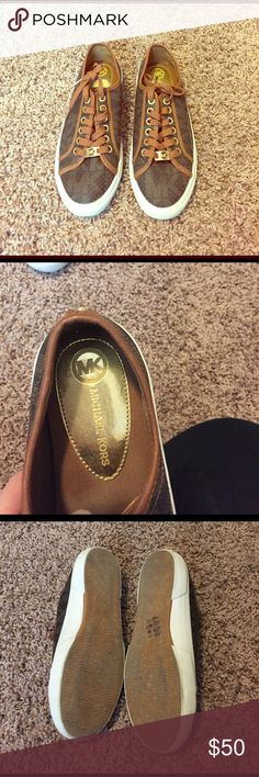 MICHAEL KORS lace up monogram sneaker Perforated brown leather light brown MK stamp throughout and caramel trim/laces gold logo bar on laces and lace ends. Worn 1 time great condition KORS Michael Kors Shoes Sneakers