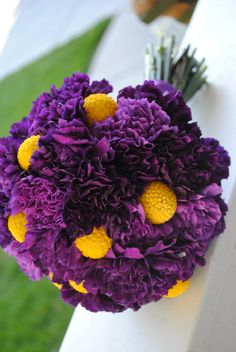 so cute!  you can get the little billy buttons (yellow balls) from a dried flower shop, and purple carnations are inexpensive