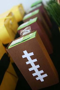 Super easy and fun DIY decoration: football juice boxes! Perfect for all the kids at your Super Bowl party!