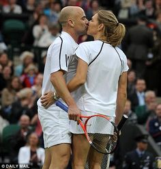 Eye off the ball: Andre and Steffi on court in a mixed doubles game.
