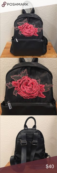 "🌹🖤Rose Embroidered Backpack🖤🌹 NWT. In major love with this babe of a backpack❣️ Black satin, gorgeous rose patch sewn on, front zipper pouch, back outside zipper pocket and one inside zipper pocket. Dark silver zippers. Sturdy adjustable straps. Gave my Mum one for Mothers Day and she LOVED IT👌🏼 Selling you mine because I Posh so hard🤣 Base is 11"" across, 5"" wide and stands 11"" high. Wear me shopping🌹😜 Kiss Me Couture  Bags Backpacks"
