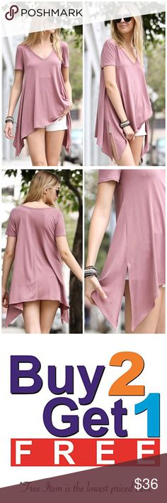 "Dust Pink Tapered Hem Top A dark dusty pink tunic featuring a v neckline and tapered hem. Perfect to pair with your favorite pair of shorts, jeans or leggings! Made of Rayon/ spandex blend.    Measurements  Small: Bust 36""/ length 25""  Medium: Bust 38""/ length 25.5"" Large: Bust 40""/ length 26"". Bchic Tops"