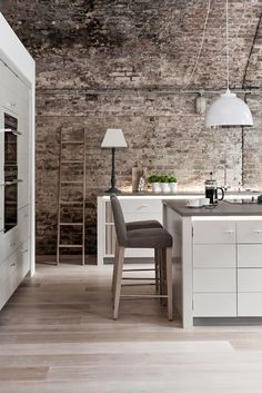 I love the kitchen and open shelving. And the wall that is made of wood!