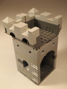 Lego Modular Castle. Here you see the two half battlement modules have been clicked into place on top of the room module. The side is left open to extend the battlement space or to connect to another module.