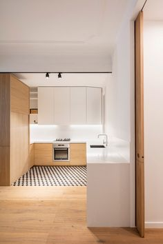 Adrian Elizalde and Clara Ocaña eschew tiles for timber in Barcelona apartment renovation