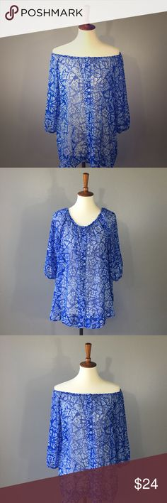 CAbi #318 shear peasant top medium Beautiful blouse, can be worn on or off shoulder. Longer length in back. 3/4 length sleeve w/ elastic.Fabric covered buttons.Excellent condition, no odors stains tears or pics. Perfect for spring!  Always stylish CAbi! CAbi Tops Blouses