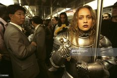 Singer Fiona Apple in a armor suit poses on a crowded New York subway, November, 1997 in New York. Fiona is best known for her moody lyrics expressed thru alternative rock and baroque pop music.
