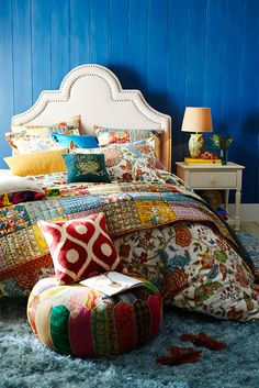 Pier 1's Spice Garden Quilt is a medley of individually selected 100% cotton prints, all stitched and quilted—with 100% cotton filling—by hand. Machine-washable and generously sized, this vibrant symphony of warm colors and patterns is the perfect foundation for a boho theme. Just add an eclectic mix of pillows in bold patterns and let this quilt stitch it all together.