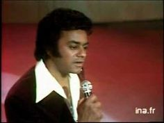 Johnny Mathis Misty....Look at me I'm as helpless as a kitten up a tree And I feel like I'm clinging to a cloud I can't understand I get misty just holding your hand  Walk my way And a thousand violins begin to play Or it might be the sound of your hello That music I hear I get misty the moment you're near