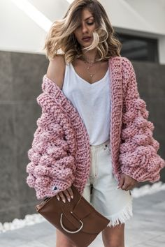 Cardigans • Warm Up Dusty Pink • Mum's Handmade • Meet the WarmUp super fluffy, chunky knit cardigan! Unique designed sleeves and relaxed fit to cuddle with on the chilly days and cooler nights. Stay fab and cozy, styling it with a loose, cotton top and your favourite bottoms for an easy and elegant off-duty dressing. Comes in OneSize, Oversized 100% Hand-knitted in Greece by our kickass mums. Mix-wool Machine (use a laundry bag) and hand washable Dry flat Do not bleach NOTICE: We hand-kn...