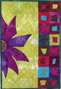 Purple Flower wall hanging Design was taken from a fused glass dish that I saw at a craft show, and adapted to quilting.