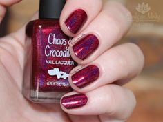 http://emilydemolly.blogspot.com/2016/01/i-want-to-believe-collaboration.html - Chaos and Crocodiles - Never give up on a miracle - a red holo with gorgeous purple undertones