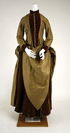 Dress  Date:     ca. 1884 Culture:     American Medium:     silk Dimensions:     (a) Length at CB: 19 1/2 in. (49.5 cm) (b) Length at CB: 39 1/2 in. (100.3 cm) Credit Line:     Gift of Mrs. Donald Ordway, 1952 Accession Number:     C.I.52.42.4a, b