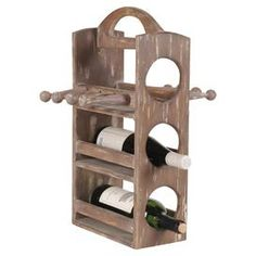 "Weathered wood wine rack with bottle and stem holders.  Product: Wine rackConstruction Material: WoodColor: NaturalFeatures:  Holds up to three bottles andHolds six glassesHandle for easy lifting Dimensions: 19.25"" H x 10.25"" W x 13.5"" D"