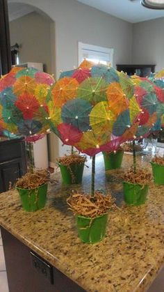 Parasol topiaries - Theses would be perfect for a beach or luau theme!