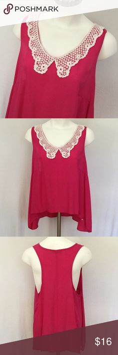 Says Saucy Top 🆕 Says Saucy Top in bright pink with crochet collar. Tank top style with hi lo hem. Excellent condition. Fresh press from cleaners. Fabric is Rayon. Says Saucy Tops