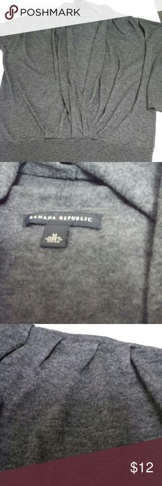 Banana Republic charcoal Grey faux wrap sweater Lightweight Grey sweater, can be worn alone or with a camisole or tank top for a layered look. Banana Republic Sweaters V-Necks
