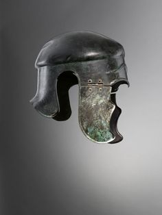 Bronze Samno-Attic helmet. 400 - 300 BCE. Open-faced helmet with no nasal-guard and hinged cheek-pieces, derived from the Chalcidian helmet.