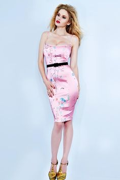 <div>Inspired by French film starlets holidaying in St Tropez, this slinky number is a Wheels & Dollbaby cocktail hour essential! The simplicity of this style`s line perfectly showcases the sought-after oriental pink seasonal print. Constructed in our signature stretch satin, upper bodice is fully lined, style features décolletage enhancing self-satin straps, invisible zip and centre back vent for ease of wear. St Tropez dress comes with black Slim 50s Velvet Belt to comp #wheelsanddollbaby