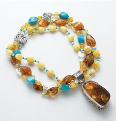 An addition to your holiday wish list? Butterscotch and Cognac Amber beaded necklace with Turquoise and white flat and micro fresh water pearls. Cognac Amber pendant with signature Sukhmani Bali Silver work……A true work of Art and one of kind!