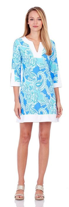 A Jude Connally favorite, the Holly is a classic tunic dress with white trim at the neckline, cuffs and hemline. With an easy fit, this style is universally flattering. Details & Fit: - Tunic style. -