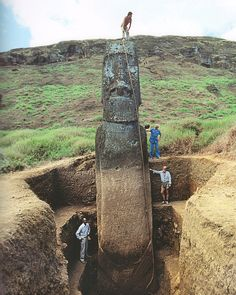 these statues are called moai, and they belong to the rapa nui, easter island, which belongs to the country of chile in south america.
