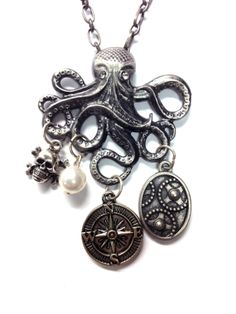 """Pirate Kraken Necklace is 19"""" long with a 1.5"""" x 1.75"""" octopus pendent, Pearl, skull and crossbones, compass and gear dangles"""