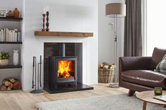 The Jens Keld 5 wood burning stove by Dik Geurts comes in two sizes; High and Low. The Keld Low is a great addition to an existing fireplace chamber due to it's 'snug' structure and shallow depth. The Keld High raises the stove up by which allows Wood Burner Fireplace, Home Fireplace, Fireplace Design, Wood Burner Stove, Gas Stove, Fireplaces, Log Burner Living Room, Home Living Room, Bathroom Ideas