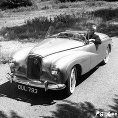 Richard Widmark at the wheel of his Sunbeam-Talbot Alpine,