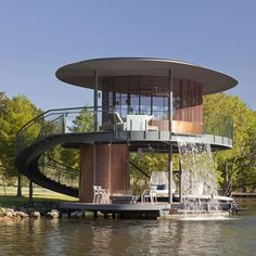 "way more modern than my taste but loving this concept for a boat ""house""/dock!"