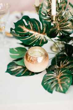 OMG I love this glamorous and tropical beach wedding table decoration! Those gold leaves are stunning! This is a great idea for a tropical yet elegant destination wedding on a budget. Wedding On A Budget, Wedding Themes, Our Wedding, Wedding Decorations, Wedding Table, Wedding Centerpieces, Wedding Reception, Tropical Centerpieces, Centrepieces