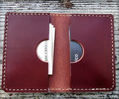 Men's leather double card wallet. Small wallet that can fit plenty of cards and cash and fits great in the front or back pocket. Available in various colors. Made in the USA.
