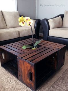 A dark stained wood storage coffee table made from repurposed wooden crates