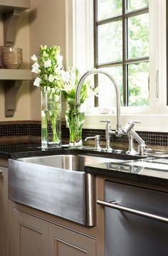 stainless farm house style kitchen sink. I've been kind of getting into the idea of these